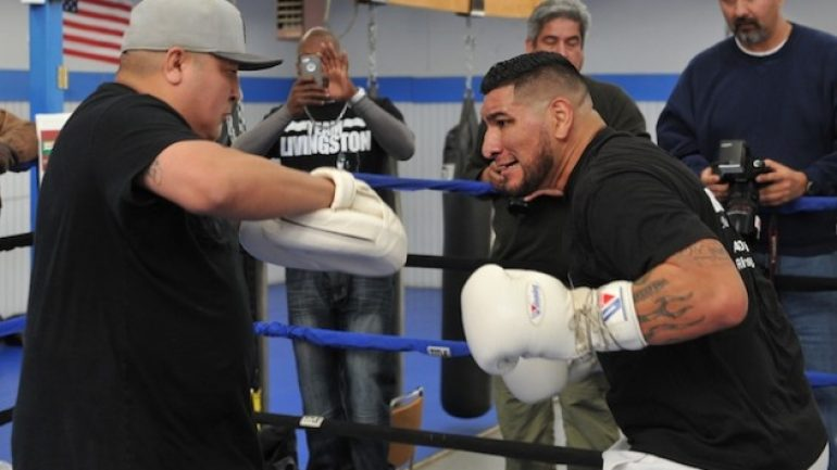 Chris Arreola fractures his ankle getting out of a car, trainer says