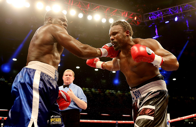 Dereck Chisora (right) charges Kevin Johnson during their heavyweight bout at The Copper Box in London, England, on Feb. 15.