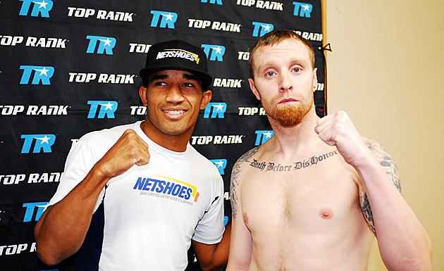 Esquiva Falcao (left) poses with his pro debut opponent Joshua Robertson after their weigh-in.