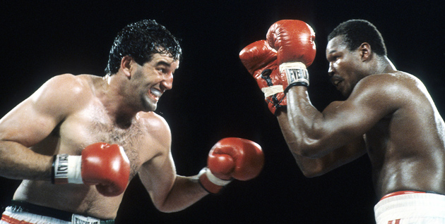 Gerry Cooney (left) looks to attack Larry Holmes during their heavyweight championship bout at Caesars Palace, Outdoor Arena in Las Vegas, Nev., in 1982.  Holmes retained the heavyweight title with a 13-round stoppage.