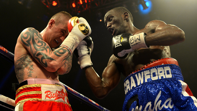Terence Crawford (right) takes it to Ricky Burns during their WBO lightweight title bout on March 1 in Glasgow. Crawford won the title by unanimous decision.