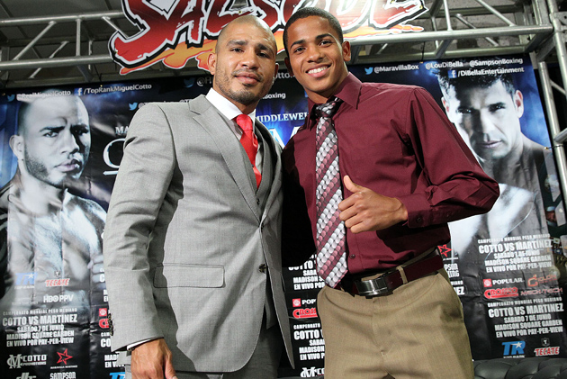 Felix Verdejo (right) poses with Puerto Rican legend Miguel Cotto at a recent press conference. Many believe that Verdejo will be Puerto Rico's next star. Photo by Chris Farina-Top Rank.