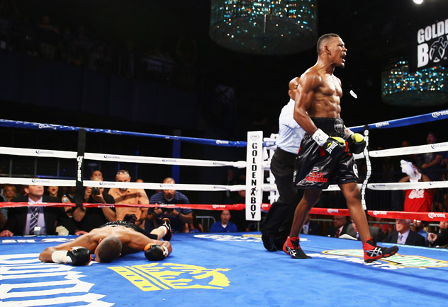 Daniel Jacobs (R) knocks out Giovanni Lorenzo in August 2013. Photo by Al Bello/Getty Images.