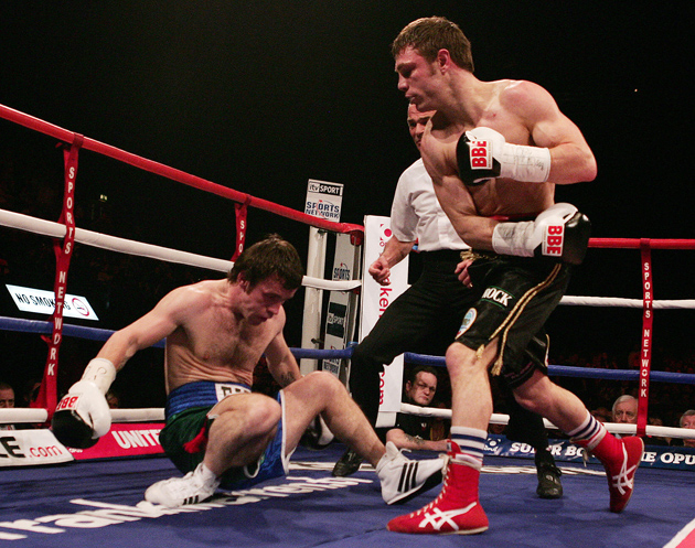 Michael Katsidis drops Graham Earl with a right during their shoot out in London in 2007. Photo by Carl De Souza-AFP