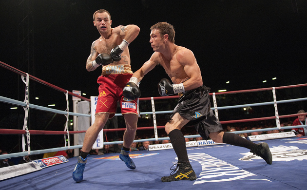 Michael Katsidis attacks Kevin Mitchell en route to stopping the unbeaten Englishman in the third round. Photo by Leon Neal-AFP