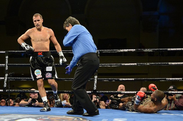 Sergey Kovalev scores the first of three knockdowns en route to stopping Cedric Agenw in Round 7 of their WBO light heavyweight title bout on March 29 in Atlantic City, N.J. Photo by Naoki Fukuda