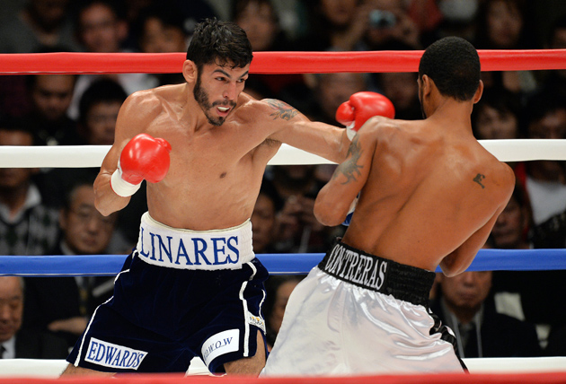 Former featherweight and junior lightweight beltholder Jorge Linares jabs at Francisco Contreras in the opening round of their fight in Tokyo on Nov. 10, 2013. Linares scored a first-round knockout. Photo by Yoshikazu Tsuno/AFP/Getty Images.