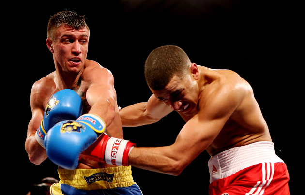 Vasyl Lomachenko (left) lands a left against Sam Maxwell during a World Series of Boxing bout at York Hall on March 1, 2013 in London, England. Lomachenko took part in six WSB bouts, which has put his professional record at the center of a divisive debate within the boxing world.