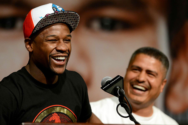 Floyd Mayweather and Robert Garcia, the trainer of Mayweather's next opponent, Marcos Maidana, had fun at the Las Vegas press conference for the May 3 event.