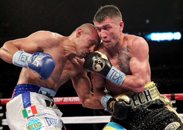 Vasyl Lomachenko (right) clashed with rugged Orlando Salido on March 1 in San Antonio. Salido won a split decision in what was billed as Lomachenko's second pro bout. Photo by Chris Farina-Top Rank
