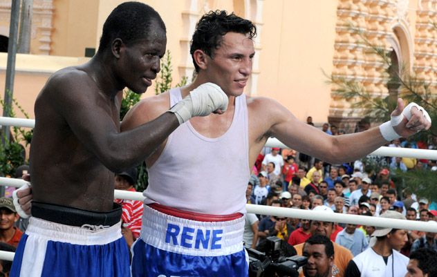 Rene Alvarado (R) at an exhibition match with Miguel Gonzalez in 2011. Photo by Orlando Sierra/AFP-Getty Images