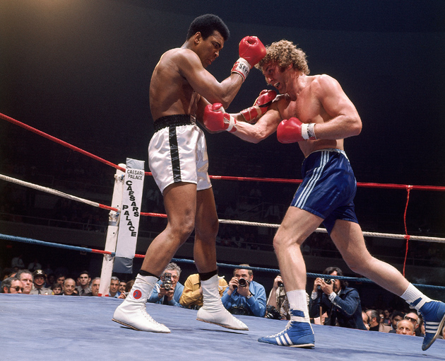 Joe Bugner takes it to Muhammad Ali in their first fight in Las Vegas in 1973. Ali won a competitive 12-round unanimous decision. Photo by Herb Scharfman/Sports - Getty Images