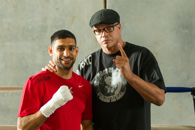 Amir Khan poses with his trainer Virgil Hunter at Hunter's gym on April 24 in Hayward, Calif., as he prepares to take on Luis Collazo at the MGM Grand in Las Vegas on May 3. Photo by Alexis Cuarezma/Getty Images