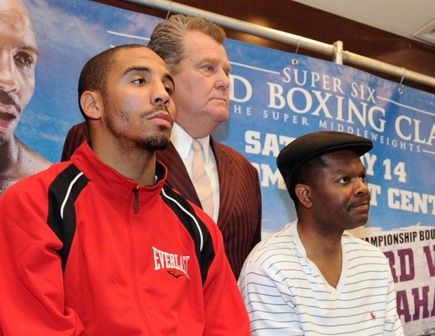 (L-R) Andre Ward, promoter Dan Goossen, and Ward's manager, James Prince, in 2011. Photo by Kevork Djansezian/Bongarts-Getty Images.