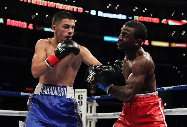 Randy Caballero (left) nails Jamal Parram with a hook during their 2012 fight at Staples Center in Los Angeles, Calif. Photo by Jeff Gross/Getty Images for Golden Boy Promotions