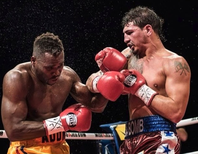 Donovan George (R) against Adonis Stevenson on Oct. 12, 2012. Photo: Hitz Boxing.
