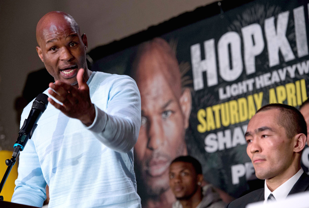 Bernard Hopkins (left) holds court while Beibut Shumenov looks on during their press conference in Washington ahead of their light heavyweight unification title fight on Saturday. Photo credit should read Nicholas Kamm/AFP/Getty Images