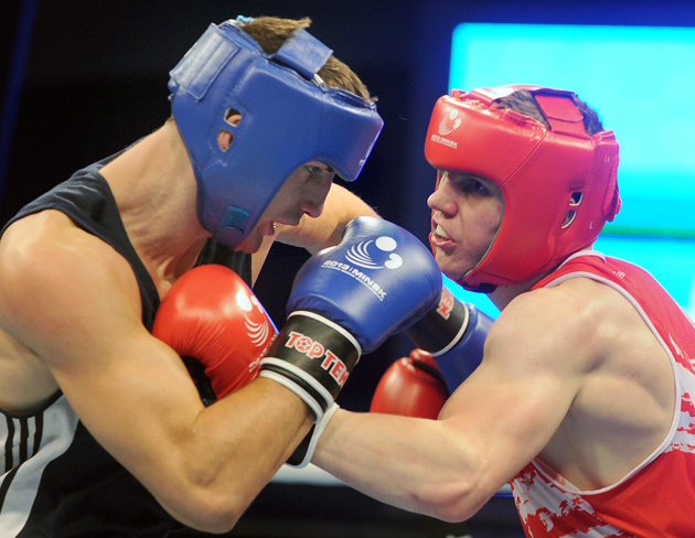Ireland's Jason Quigley (right) fights against Romania's Bogdan Juratoni during their European Amateur Championships final match on June 8, 2013 in Minsk. Quigley defeated Juratoni. Photo by Viktor Dravchev/AFP/Getty Images