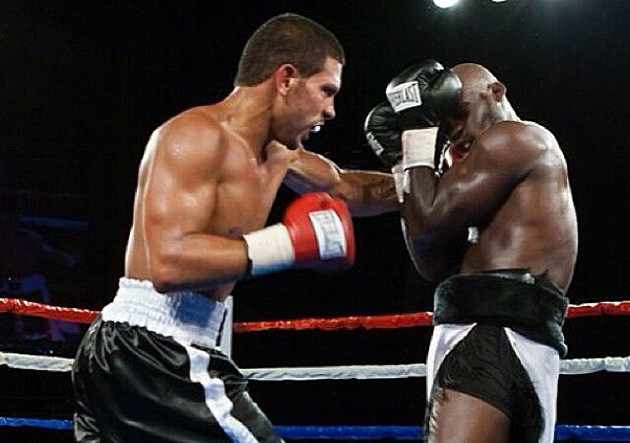 Juan Rodriguez Jr. lands a left hook to Greg Hackett en route to winning a six-round decision on July 29, 2011. Photo courtesy of KEA Promotions