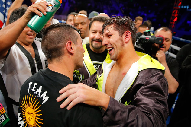 Jphn Molina (R) congratulates Lucas Matthysse following their fight on April 26, 2014. Photo by Joe Scarnici/Getty Images.