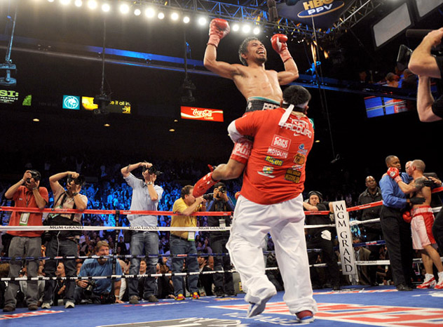 Manny Pacquiao celebrates after his victory over Miguel Cotto on Nov. 14, 2009. Photo by Gabriel Buoys/AFP-Getty Images.