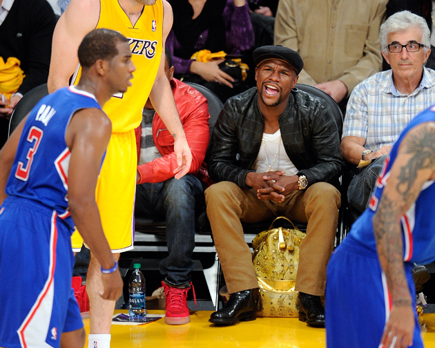 Floyd Mayweather Jr. attends a game between the Los Angeles Clippers and the Los Angeles Lakers at Staples Center on Oct. 29, 2013 in L.A. Mayweather says he's interested in buying the Clippers in the wake of the Donald Sterling controversy. Photo by Noel Vasquez/Getty Images