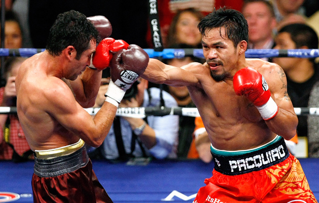 Manny Pacquiao (right) jabs Oscar De La Hoya in the fifth round of their welterweight bout at the MGM Grand in Las Vegas on Dec. 6, 2008. Photo by Ethan Miller-Getty Images
