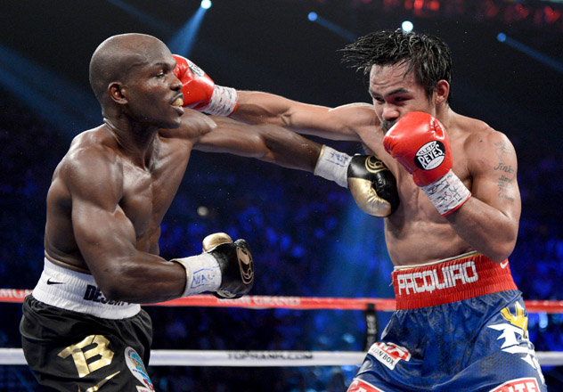 Tim Bradley (L) and Manny Pacquiao swap punches during their first fight, on June 9, 2012. Photo by Kevork Djansezian.