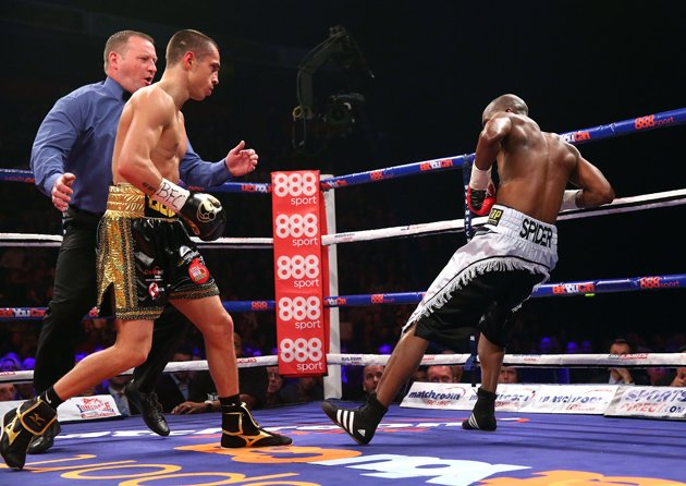 Scott Quigg knocks down Tshifhiwa Munyai for the second time during their junior featherweight fight at MEN Arena on April 19 in Manchester, England. Photo by Alex Livesey/Getty Images
