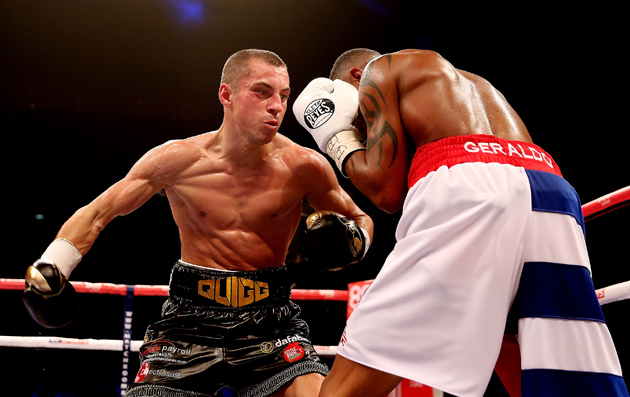 Scott Quigg (left) takes it to former Cuban amateur standout Yoandris Salinas during their 12-round junior featherweight draw at O2 Arena on Oct. 5, 2013 in London, England. Photo / Scott Heavey-Getty Images