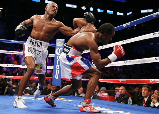 Middleweight beltholder Peter Quillin staggers Fernando Guerrero en route to one of the four knockdowns he scored prior to stopping Guerrero in the seventh round of their WBO title fight at Barclays Center on April 27, 2013 in Brooklyn N.Y. Photo by Elsa/Getty Images