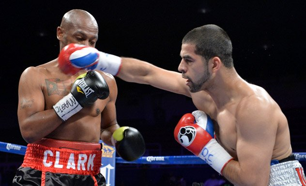 Sadam Ali (R) fighting Michael Clark on the April 19 undercard of Bernard Hopkins vs. Beibut Shumenov in Washington, D.C. Photos by Nicholas Kamm/AFP-Getty Images.