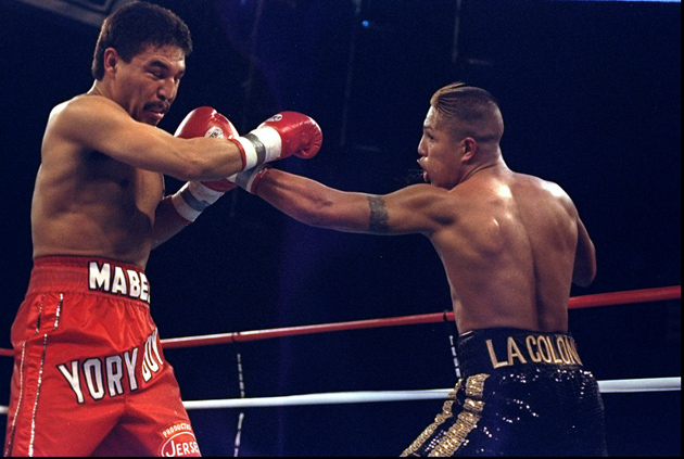 Fernando Vargas (right) lands a left jab en route to stopping Yory Boy Campas in the seventh round to become the youngest 154-pound titleholder in history at the Taj Mahal in Atlantic City, N.J., in 1998. Photo by Al Bello-Getty Images