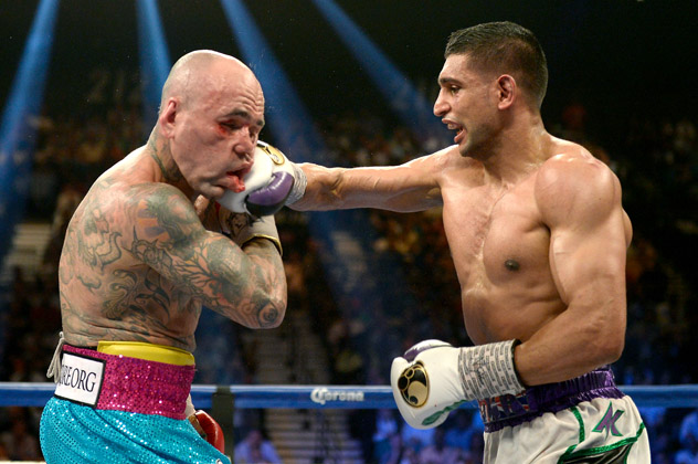 Amir Khan catches Luis Collazo with a right cross en route to outpointing the veteran on May 3, 2014, in Las Vegas, Nev. Photo by Naoki Fukuda