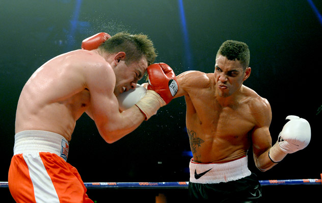 Middleweight Anthony Agogo (R) fighting Greg O'Neill on March 1, 2014. Photo by Mark Runnacles/Getty Images.