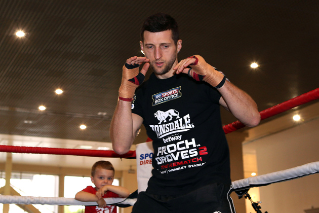 IBF super-middleweight titleholder Carl Froch works out with son Rocco looking on at Broadmarsh Shopping Centre on May 26 in Nottingham, England. Photo by Jan Kruger/Getty Images