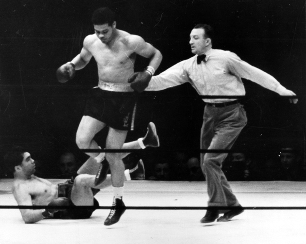 Joe Louis steps over Max Schmeling after knocking him down during their legendary rematch on June 22, 1938 at Yankee Stadium in Bronx, NY. Louis won by first-round KO. Photo / The Ring Magazine-Getty Images