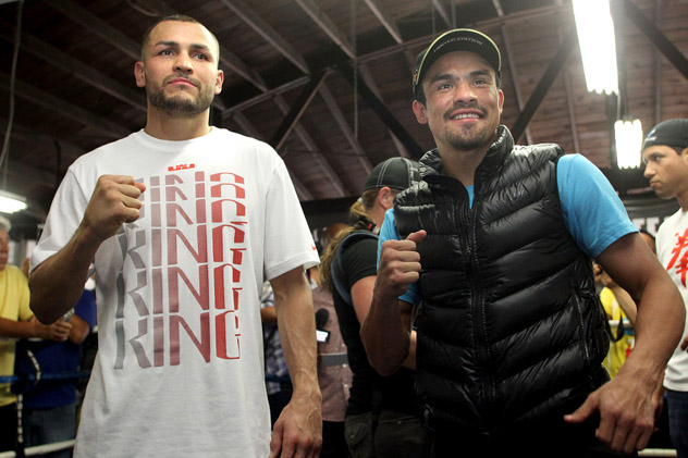 Mike Alvarado poses with Juan Manuel Marquez at Azteca Boxing Club in Bell, Calif., the week of their fight. Photo by Chris Farina-Top Rank