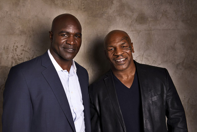 Evander Holyfield (L) with Mike Tyson at the 2014 Tribeca Film Festival. Photo by Larry Busacca/Getty Images.