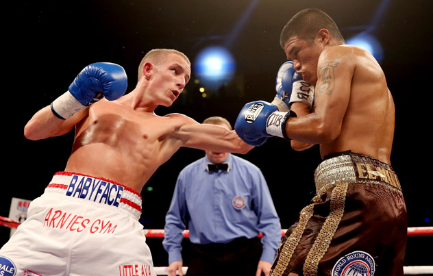 Paul Butler (L) in action against Ruben Montoya in December 2013. Photo by Scott Heavey/Getty Images.