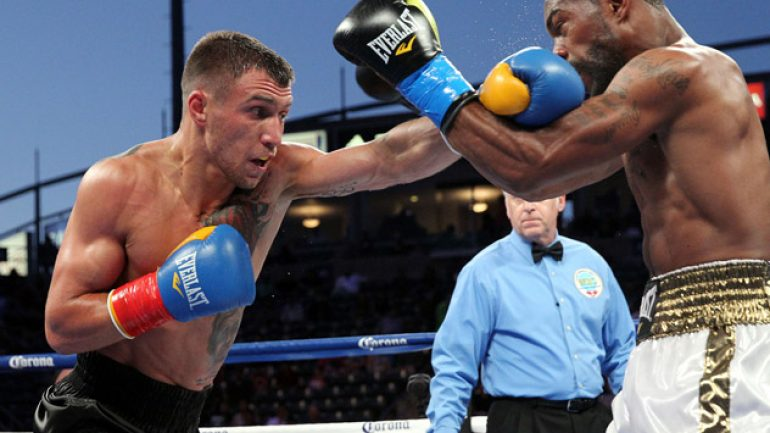 Vasyl Lomachenko claims world title in third pro bout