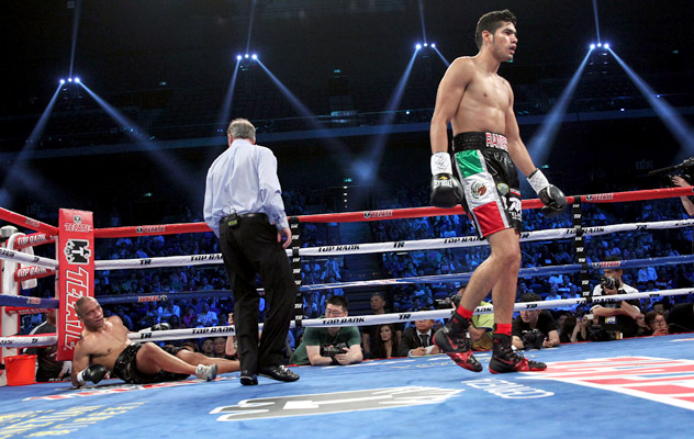 July 19, 2014: Gilberto Ramirez leaves a fallen Junior Talipeau behind on his way to a first-round stoppage in Macau. Photo by Chris Farina/Top Rank.