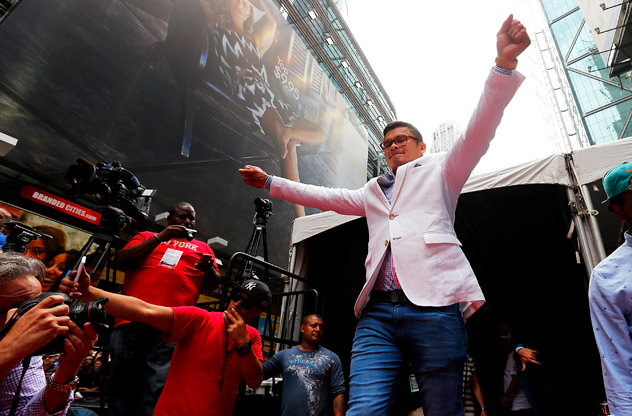 Marcos Maidana makes his entrance at New York's Times Square for the first stop of a publicity tour for his rematch against Floyd Mayweather Jr. Photo by Mike Stobe/Getty Images.