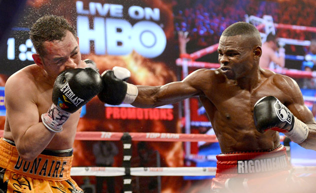 Guillermo Rigondeaux (R) fighting then-RING jr. featherweight champion Nonito Donaire in April 2013. Photo by Naoki Fukuda.