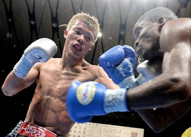 Tomoki Kameda (L) lands a left hook on Immanuel Naidjala during a defense of his WBO bantamweight title on December 3, 2013, in Osaka, Japan. Photo by JIJI PRESS/AFP-Getty Images.