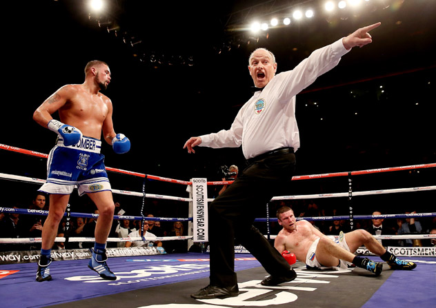 March 15, 2014: Tony Bellew (L) floors Valery Brudov for a 12th-round knockout in Bellew's first fight at cruiserweight. Photo by Scott Heavey/Getty Images.