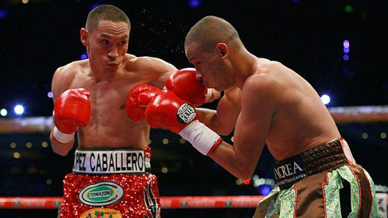 Juan Estrada stops Giovani Segura in 11, retains WBA, WBO flyweight titles