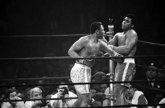 Joe Frazier-Muhammad Ali I. Photo from THE RING archives
