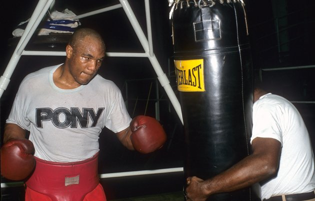 George Foreman woks the heavy bag during a media workout prior to announcing his comeback in February 1988. Photo by: The Ring Magazine/Getty Images