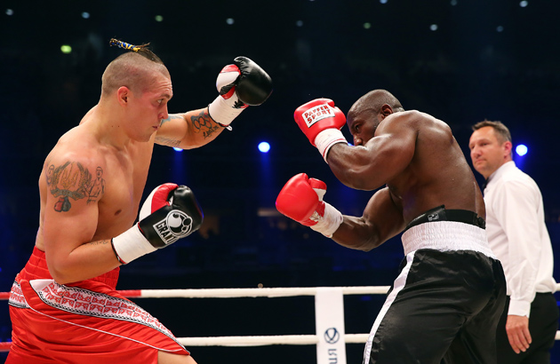 Oleksandr Usyk (left) exchange punches with Ben Nsafoah during their cruiserweight fight at Koenig-Pilsner Arena on April 26, 2014 in Oberhausen, Germany. Photo by Martin Rose/Bongarts/Getty Images